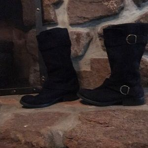 Black suede-like boots with gold buckles.